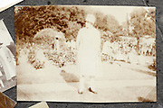 very faded image of woman standing in a public garden 1920s