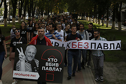 July 20, 2017 - Kiev, Ukraine - A few hundred activists and media representatives march downtown Kyiv, Ukraine pass by the President Office and Internal Ministry from the site where journalist Pavlo Sheremet was killed in a car explosion year ago, to commemorate their college and demand from the officials to investigate the case, July 20, 2017. (Credit Image: © Sergii Kharchenko/NurPhoto via ZUMA Press)