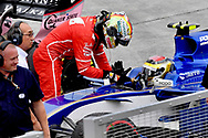 Pascal Wehrlein of Sauber gives Sebastian Vettel of Scuderia Ferrari a lift back to the pits, following his crash, during the Malaysian Formula One Grand Prix at the Sepang International Circuit, Malaysia.<br /> Picture by EXPA Pictures/Focus Images Ltd 07814482222<br /> 01/10/2017<br /> *** UK &amp; IRELAND ONLY ***<br /> <br /> EXPA-EIB-171001-0240.jpg