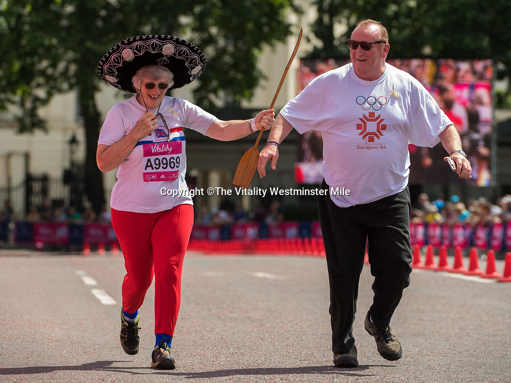 Slvia Lunn finishes in the Olympian Wave at the finishing line outside Buckingham Palace at The Vitality Westminster Mile, Sunday 28th May 2017.<br /> <br /> Photo: Thomas Lovelock for The Vitality Westminster Mile<br /> <br /> For further information: media@londonmarathonevents.co.uk