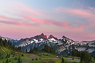 Sunset glow on the Tatoosh Range peaks in Mount Rainier National Park, Washington State, USA