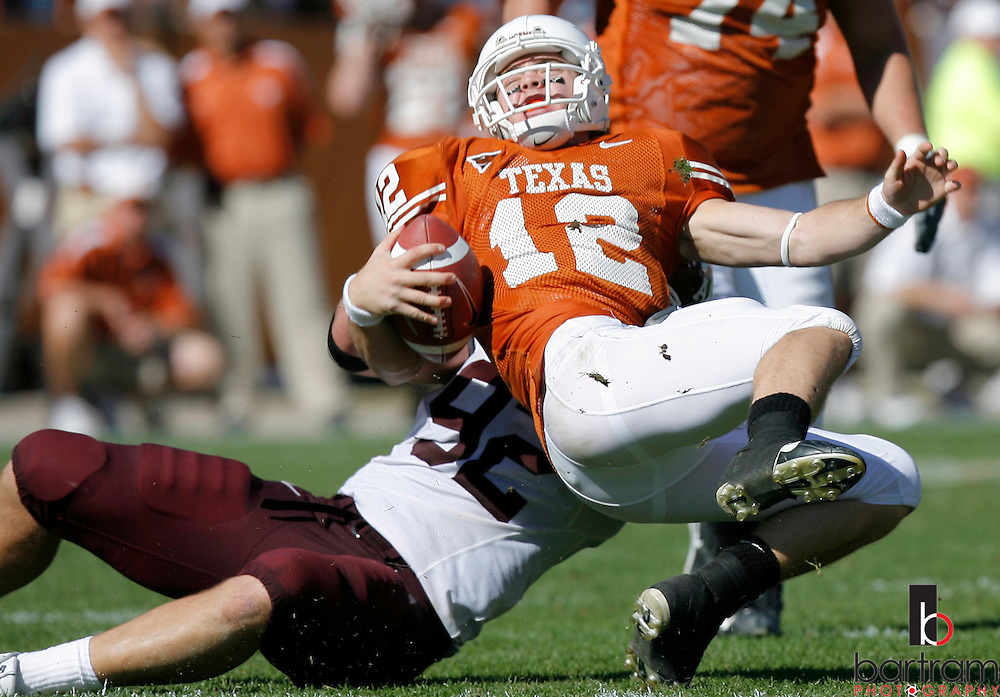 University of Texas quarterback Colt McCoy is tackled during a game against Texas A&M at the University of Texas on Friday, Nov. 24, 2006. Texas A&M won 12-7.