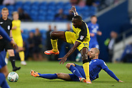 Lucas Akins of Burton Albion is tackled by Matthew Connolly of Cardiff city. Carabao Cup 2nd round match, Cardiff city v Burton Albion at the Cardiff City Stadium in Cardiff, South Wales on Tuesday 22nd August  2017.<br /> pic by Andrew Orchard, Andrew Orchard sports photography.