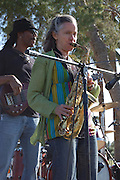 Nick Augustine plays bass and Heidi Wilson is on saxophone with the Mitzi Cowell Band during their  Solar Rock concert in Himmel Park, Tucson, Arizona.