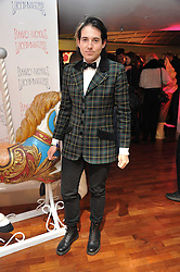 RICHARD DENNEN at a party to celebrate the launch of the Lucy in Disguise Ready to Wear collection exclusive to Harvey Nichols, held at The Fifth Floor Restaurant, Harvey Nichols, Knightsbridge, London on 25th May 2011.