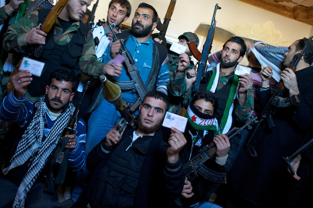 January 20, 2012 - Idleb, Syria: A group of Free Syria Army soldiers pose for a portrait in a safe house in a location near the revolution stronghold city of Idleb.