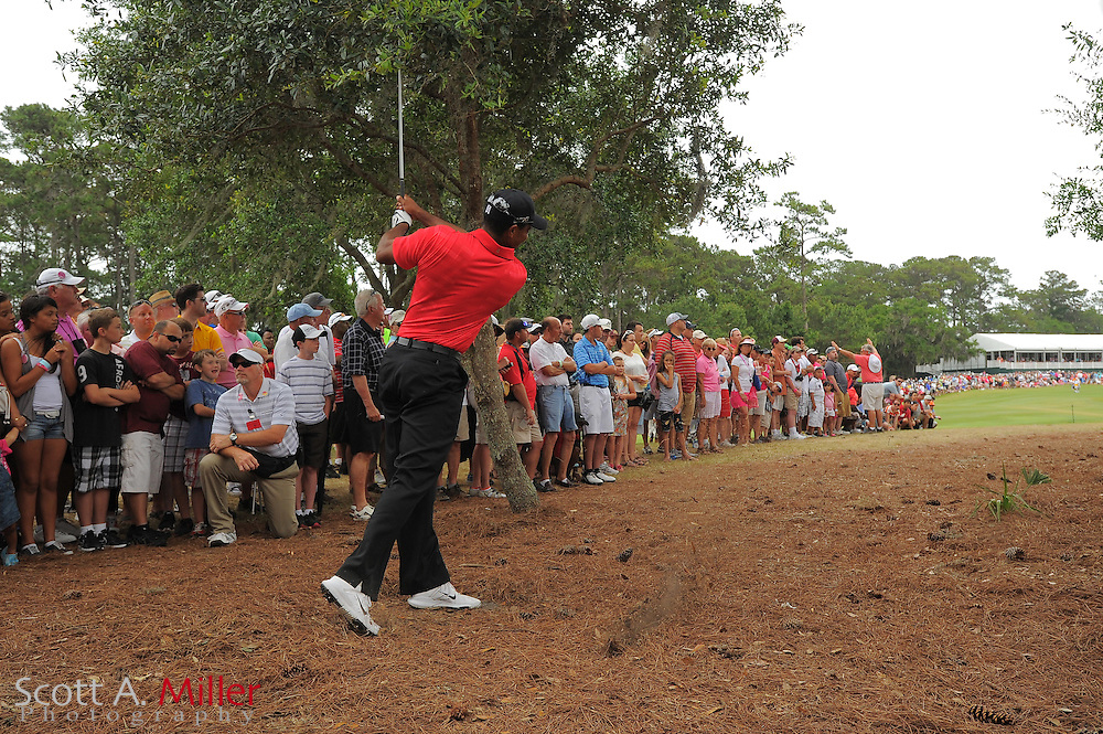 Tiger Woods hits from the rough on the 16th hole during the final round of the Players Championship at the TPC Sawgrass on May 13, 2012 in Ponte Vedra, Fla. ..©2012 Scott A. Miller..