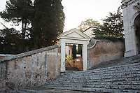 ROME, ITALY - 27 AUGUST 2016: The entrance gate that leads to the Mother House of the Missionaries of Charity, the religious congregation founded by Mother Teresa in 1950, is seen here next to the San Gregorio al Celio church in Rome, Italy, on August 27th 2016.<br /> <br /> Mother Teresa, also known as Blessed Teresa of Calcutta, was an Albanian Roman Catholic nun and missionary. She founded the Missionaries of Charity, a Roman Catholic religious congregation, whose members must adhere to the vows of chastity, poverty, and obedience, as well as the vow to give wholehearted free service to the poorest of the poor. Shortly after she died in 1997, Pope John Paul II waived the usual five-year waiting period and allowed the opening of the process to declare her sainthood. She was beatified in 2003. A second miracle was credited to her intercession by Pope Francis, in December 2015, paving the way for her to be recognised as a saint by the Roman Catholic Church. Her canonisation is scheduled for September 4th 2016, a day before the 19th anniversary of her death.