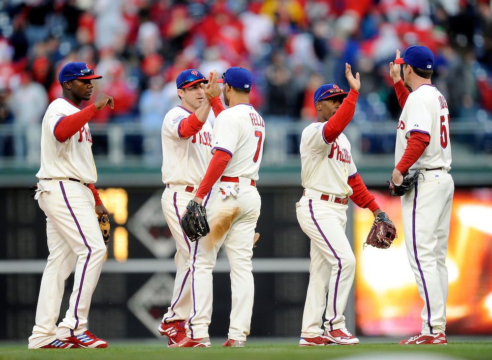 PHILADELPHIA - APRIL 08: Members of the Philadelphia Phillies  celebrate a victory against the Atlanta Braves at Citizens Bank Park on April 8, 2009 in Philadelphia, Pennsylvania. The Phillies defeated the Braves 12 to 11.(Photo by Rob Tringali) *** Local Caption ***