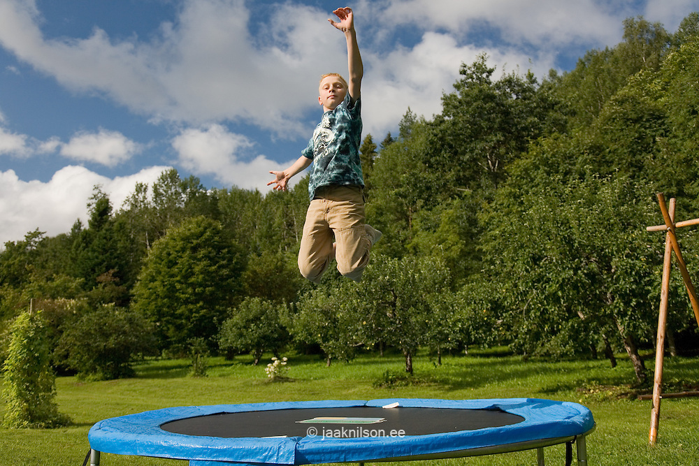 Teenage Boy Jumping on Trampoline