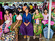 20 NOVEMBER 2017 - YANGON, MYANMAR: Passengers on the Dala Ferry going to Yangon. Tens of thousands of commuters ride the ferry every day. It brings workers into Yangon from Dala, a working class community across the river from Yangon. A bridge is being built across the river, downstream from the ferry to make it easier for commuters to get into the city.     PHOTO BY JACK KURTZ