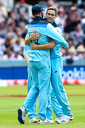 Chris Woakes of England celebrates with teammates after taking the wicket of Colin de Grandhomme of New Zealand - Mandatory by-line: Robbie Stephenson/JMP - 14/07/2019 - CRICKET - Lords - London, England - England v New Zealand - ICC Cricket World Cup 2019 - Final