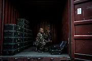 16th BC French unit soldier stores his weapons in a container that will go back to France on September 25, 2012  in Warehouse base in Kabul. The French unit from Bitche (Moselle) will spend a week disassembling weapons, cleanning tanks and preparing their departure for France. AFP PHOTO / JEFF PACHOUD