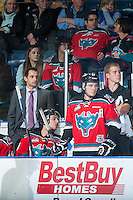 KELOWNA, CANADA - OCTOBER 31: Travis Crickard, assistant coach and Brendan Hait, equipment manager of the Kelowna Rockets stand on the bench against the Lethbridge Hurricanes on October 31, 2015 at Prospera Place in Kelowna, British Columbia, Canada.  (Photo by Marissa Baecker/Shoot the Breeze)  *** Local Caption *** Travis Crickard; Brendan Hait;