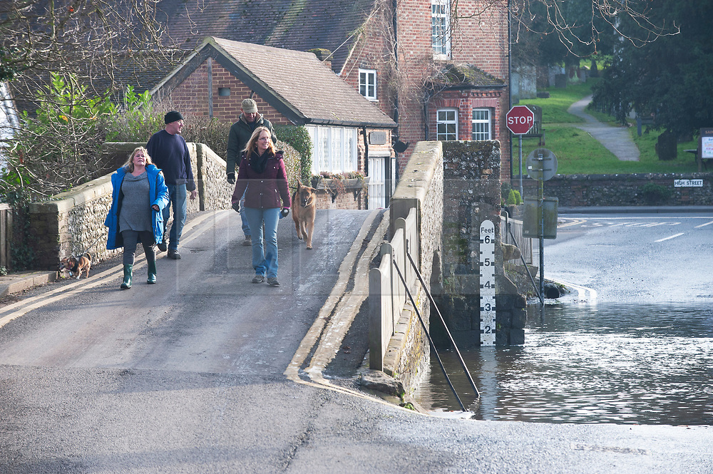 ©Licensed to London News Pictures 29/12/2019. <br /> Eynsford ,UK.People get out and about in the sunny mild weather in Eynsford,Kent as the flood water from the river Darent recedes .Photo credit: Grant Falvey/LNP
