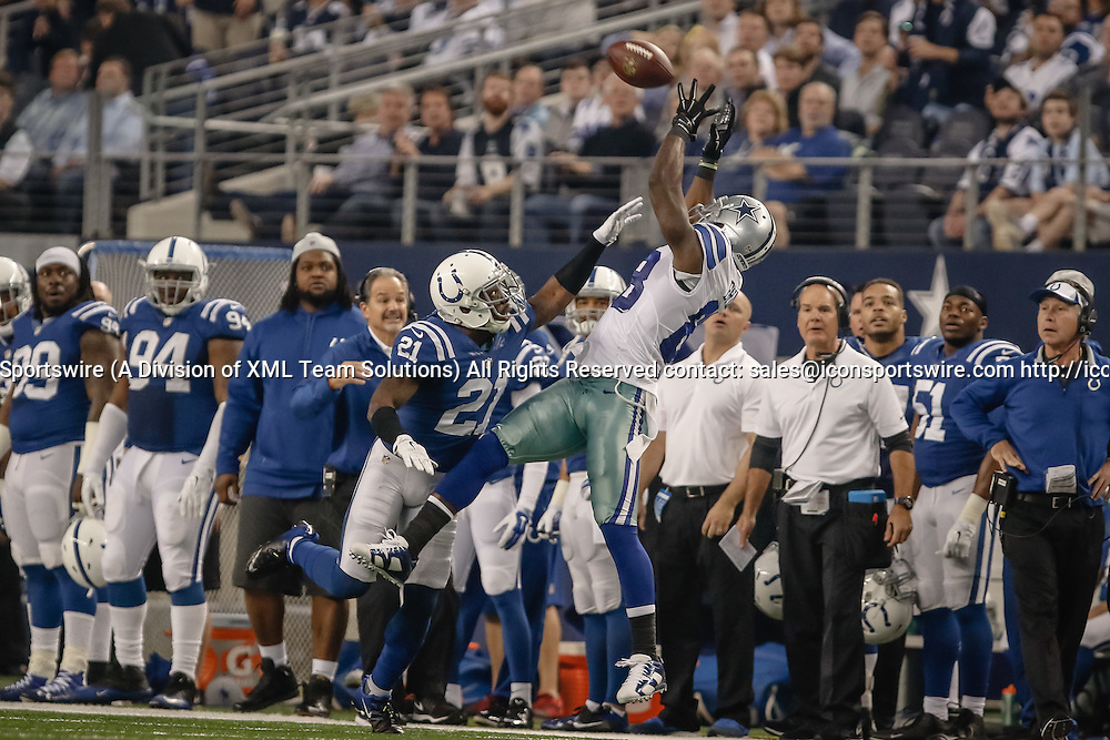 21 DEC 2014: Dallas Cowboys Wide Receiver Dez Bryant (88) [11280] makes a catch over Indianapolis Colts Cornerback Vontae Davis (21) [11333] during the NFL game between the Dallas Cowboys and the Indianapolis Colts at AT&T Stadium in Arlington, TX.