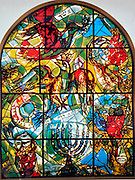 The Tribe of Asher. The Twelve Tribes of Israel depicted in stained glass By Marc Shagall (1887 - 1985). The Twelve Tribes are Reuben, Simeon, Levi, Judah, Issachar, Zebulun, Dan, Gad, Naphtali, Asher, Joseph, and Benjamin.