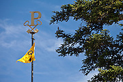 Emblem and flag at the famous Chateau Petrus wine estate at Pomerol in the Bordeaux region of France