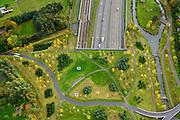 Nederland, Noord-Brabant, Gemeente Breda, 23-10-2013; Infrabundel, combinatie van autosnelweg A16 gebundeld met de spoorlijn van de HSL (li). Stadsduct Overbos in de voorgrond. De bundel loopt in tunnelbakken, lokale wegen gaan over deze infrabundel heen, door middel van de zogenaamde stadsducten, gedeeltelijk ingericht als stadspark. Combination of motorway A16 and the HST railroad, crossed by local roads by means of *urban ducts*, partly designed as public parks.<br /> luchtfoto (toeslag op standard tarieven);<br /> aerial photo (additional fee required);<br /> copyright foto/photo Siebe Swart