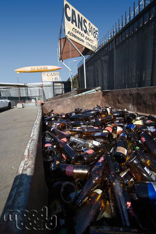 Pile of glass bottles in bin