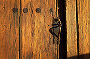 Mission San Xavier del Bac. Small door in larger one, main entrance, 200-yr.-old mesquite doors, Tucson, Arizona. ..Subject photograph(s) are copyright Edward McCain. All rights are reserved except those specifically granted by Edward McCain in writing prior to publication...McCain Photography.211 S 4th Avenue.Tucson, AZ 85701-2103.(520) 623-1998.mobile: (520) 990-0999.fax: (520) 623-1190.http://www.mccainphoto.com.edward@mccainphoto.com.
