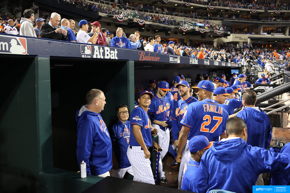 Ruben Tejada, New York Mets, in the dugout with team mates before the New York Mets Vs Los Angeles Dodgers, game three of the NL Division Series at Citi Field, Queens, New York. USA. 12th October 2015. Photo Tim Clayton for The Players Tribune