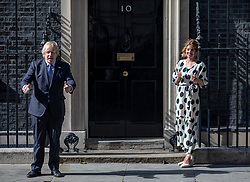 "© Licensed to London News Pictures. 05/07/2020. London, UK. Prime Minister Boris Johnson and Annemarie Plas, who started the weekly ""clap for carers"", join a nationwide applause from the steps of 10 Downing Street to mark the 72nd anniversary of the NHS. Photo credit: Rob Pinney/LNP"