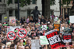 © Licensed to London News Pictures . 20/06/2015 . London , UK . People filling Parliament Square . Tens of thousands of people march from the Bank of England to Parliament , to protest economic austerity in Britain . Photo credit: Joel Goodman/LNP