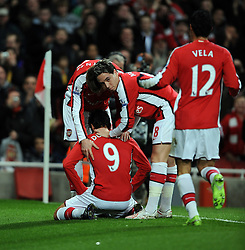Eduardo celebrates scoring the 1st goal with his team mates during the FA Cup 4th Round Replay between Arsenal and Cardiff City at the Emirates Stadium on February 16, 2009 in London, England.