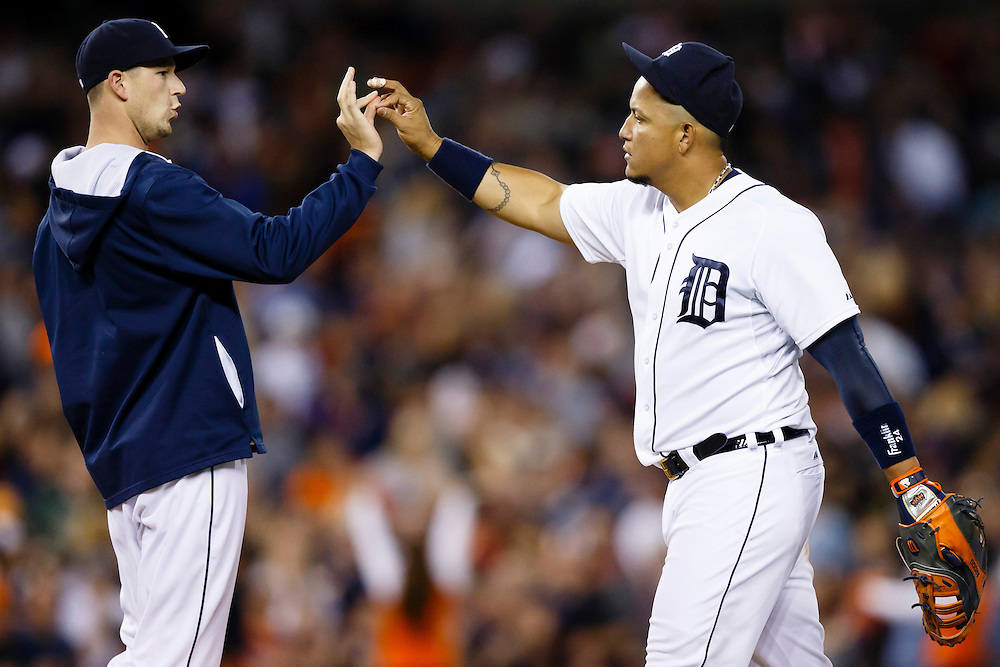 May 23, 2014; Detroit, MI, USA; Detroit Tigers starting pitcher Drew Smyly (left) and first baseman Miguel Cabrera (24) celebrate after the game against the Texas Rangers at Comerica Park. Detroit won 7-2. Mandatory Credit: Rick Osentoski-USA TODAY Sports