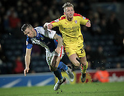 Shane Duffy (Blackburn Rovers) and Luke Hyam (Rotherham United) come together and go airborne during the Sky Bet Championship match between Blackburn Rovers and Rotherham United at Ewood Park, Blackburn, England on 11 December 2015. Photo by Mark P Doherty.