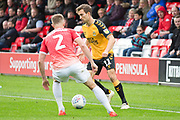 Cambridge United midfielder Harrison Dunk challenged by Salford City defender Scott Wiseman during the EFL Sky Bet League 2 match between Salford City and Cambridge United at Moor Lane, Salford, United Kingdom on 12 October 2019.