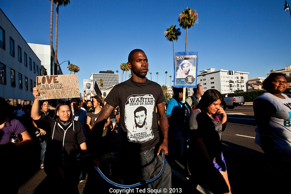 A protest marches through the posh city of Beverly Hills, in response to the Trayvon Martin murder verdict. Around 200 people marched up to Rodeo Drive, one of the world's most exclusive streets and held a rally calling for justice for Trayvon Martin. No one was arrested and the march was peaceful.