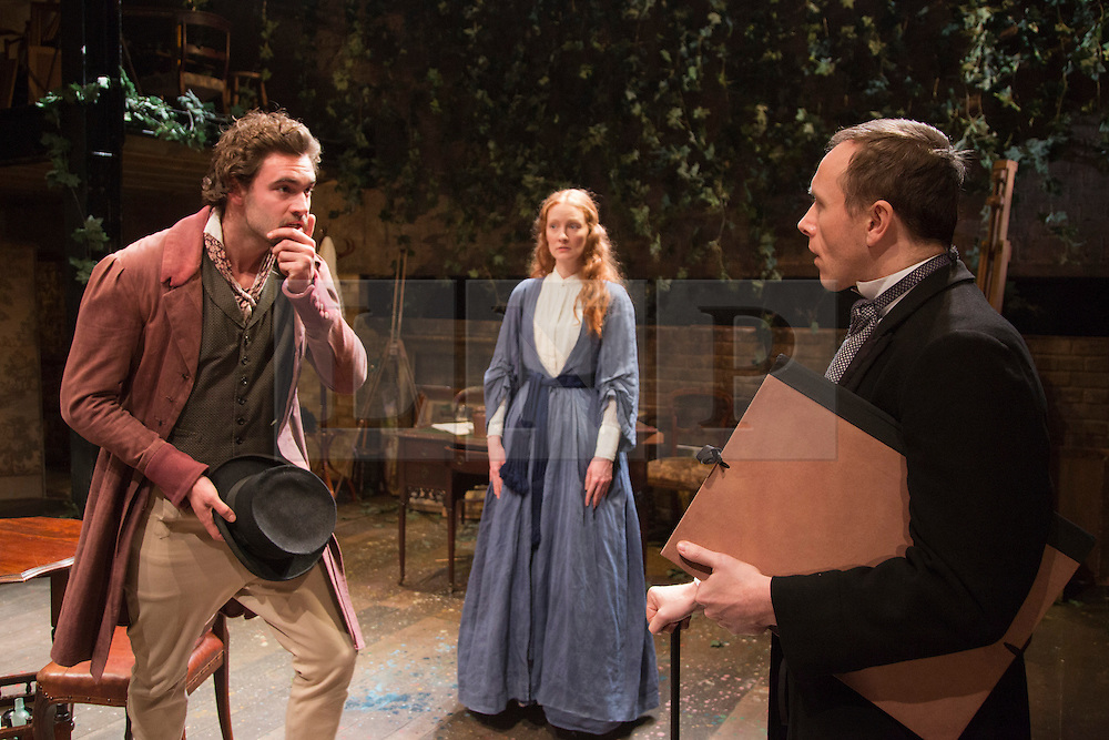 """© Licensed to London News Pictures. 21/11/2013. London, England. L-R: Tom Bateman as Dante Gabriel Rossetti, Emma West as Lizzie Siddal and Daniel Crossley as John Rushkin. World premiere of the play """"Lizzie Siddal"""" at the Arcola Theatre, Hackney, London. The play tells the story of the woman who was 'Ophelia' in Millais' famous painting. Running from 20 November to 21 December 2013. With Emma West as Lizzie Siddal and Tom Bateman as Dante Gabriel Rossetti. Photo credit: Bettina Strenske/LNP"""