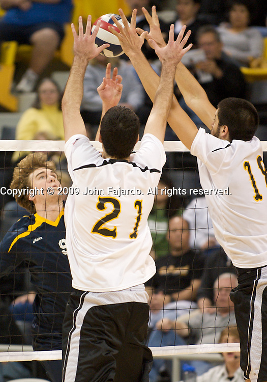 Dan Alexander(21) and Dean Bittner(18) block Carson Clark(9) at the net in the home opener against UC Irvine at the Walter Pyramid, Long Beach CA, Friday, January 23, 2009.  The 49er's lose in four sets, 34-32, 32-30, 28-30, 30-27.