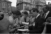 Nissan International Cycle Race..1986..01.10.1986..10.01.1986..1st October 1986..The Nissan Classic began today from Trinity College,Dublin. The offical race starter was The Taoiseach,Dr Garrett FitzGerald TD. He was accompanied by the Minister for Sport,Mr Sean Barrett TD..Sean Kelly was returning to defend his title but his opposition included Greg LeMond, the 1983 world champion and the winner of the Tour de France of the previous July. Roche was out due to his injured leg. Adri van der Poel was back with 1980 Tour de France winner and 1985 world champion Joop Zoetemelk. Teun van Vliet was back too. The winner of the green jersey of the Tour de France that July, Eric Vanderaerden was there as well as Australians Phil Anderson and Alan Peiper as well the Scottish cyclist Robert Millar...Image of Sean Kelly, in his Guinness/Kas race attire, signing his autograph for Mr Gerard O'Toole,Managing Director,Nissan Ireland