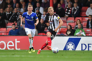 Grimsby Town defender Harry Davis(24) and Oldham Athletic forward Sam Surridge (9) during the EFL Sky Bet League 2 match between Grimsby Town FC and Oldham Athletic at Blundell Park, Grimsby, United Kingdom on 15 September 2018.