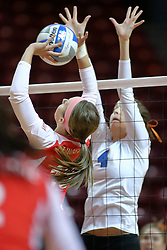 29 October 2011: Kaitlyn Early sets the ball for a strike as Heather Thorson lifts for a blockDuring a match between the Creighton Bluejays and the Illinois State Redbirds at Redbird Arena in Normal Illinois