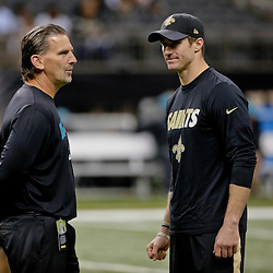 Dec 27, 2015; New Orleans, LA, USA; Jacksonville Jaguars offensive coordinator Greg Olsen talks to New Orleans Saints quarterback Drew Brees (9) prior to a game at the Mercedes-Benz Superdome. Mandatory Credit: Derick E. Hingle-USA TODAY Sports