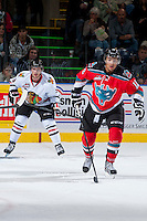 KELOWNA, CANADA - OCTOBER 4:  Tyrell Goulbourne #12 of the Kelowna Rockets and Chase De Leo #9 of the Portland Winterhawks skates on the ice against the Kelowna Rockets  at the Kelowna Rockets on October 4, 2013 at Prospera Place in Kelowna, British Columbia, Canada (Photo by Marissa Baecker/Shoot the Breeze) *** Local Caption ***