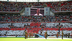 LONDON, ENGLAND - Saturday, June 4, 2011: England supporters hold up cards to make a giant St. George's Cross before the UEFA Euro 2012 qualifying Group G match against Switzerland at Wembley Stadium. (Photo by David Rawcliffe/Propaganda)
