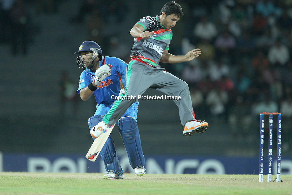 Yuvraj Singh and Gilbadin Naib almost clash during the ICC World Twenty20 match between India and Afghanistan held at the Premadasa Stadium in Colombo, Sri Lanka on the 19th September 2012<br /> <br /> Photo by Ron Gaunt/SPORTZPICS
