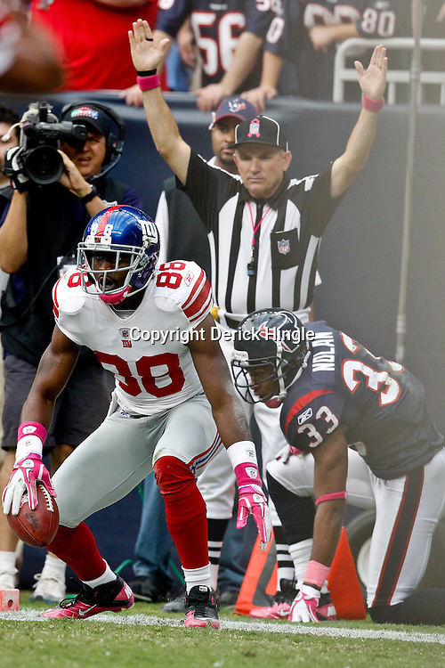 October 10, 2010; Houston, TX USA; New York Giants wide receiver Hakeem Nicks (88) reacts after scoring a touchdown past Houston Texans safety Troy Nolan (33) during the first half at Reliant Stadium. Mandatory Credit: Derick E. Hingle
