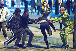 © Licensed to London News Pictures . 07/04/2017 . Manchester , UK . 3rd in a sequence . Five youths on one as a fight breaks out in Piccadilly Gardens . Greater Manchester Police have authorised dispersal powers and say they will ban people from the city centre for 48 hours , this evening (7th April 2017) , in order to tackle alcohol and spice abuse . Photo credit : Joel Goodman/LNP