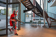 UNITED KINGDOM, London: A cosplay fan dressed as Spawn returns to his hotel after visiting the MCM London Comic Con at the ExCel Arena in east London. The three day event, which finishes today is said to have brought 130,000 comic con fans and cosplay enthusiasts. Rick Findler / Story Picture Agency