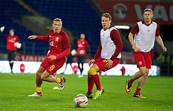 11.10.2013, City Stadion, Cardiff, WAL, FIFA WM Qualifikation, Wales vs Mazedonien, Gruppe A, im Bild Wales' Craig Bellamy, Chris Gunter and Simon Church warm-up before the FIFA World Cup Qualifier Group A Match between Wales and Macedonia at the City Stadium, Cardiff, Wales on 2013/10/11. EXPA Pictures © 2013, PhotoCredit: EXPA/ Propagandaphoto/ David Rawcliffe<br /> <br /> ***** ATTENTION - OUT OF ENG, GBR, UK *****