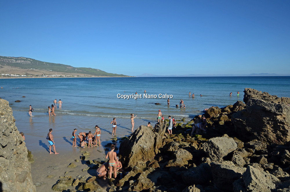 People apply muds on Bolonia beach, Tarifa