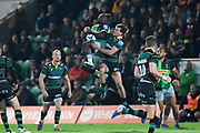 Harlequins wing Gabriel Ibitoye (11) catches the ball under pressure from Northampton Saints fullback George Furbank (15)during the Gallagher Premiership Rugby match between Northampton Saints and Harlequins at Franklins Gardens, Northampton, United Kingdom on 1 November 2019.