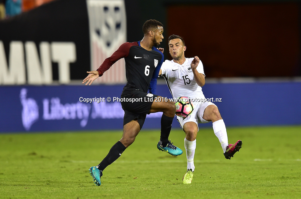 Clayton Lewis of New Zealand and Kellyn Acosta clash.<br /> Washington, D.C. - October 11, 2016: The U.S. Men's National team take 1-0 lead over New Zealand in first half play in an international friendly game at RFK Stadium.<br /> Copyright photo: Brad Smith / www.photosport.nz
