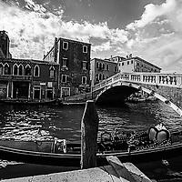 Where:  Venice, Italy. Gondola and Venetian architecture.